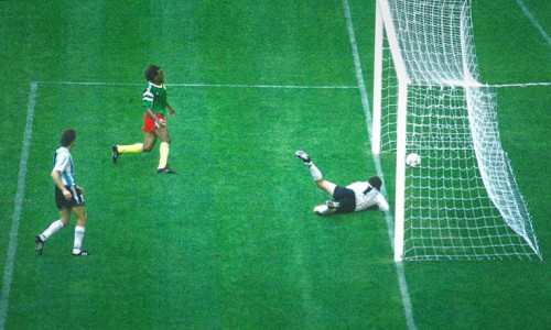 Cameroon's Omam Biyik scores the winning goal against Argentina goalkeeper Pumpido, during the soccer World Cup opening match, in San Siro Stadium, in Milan, Italy, June 9, 1990. Cameroon had a shock victory over Argentina, 1-0 the final score. (AP Photo/Carlo Fumagalli)