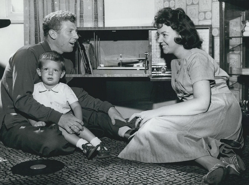 Colin-Grainger and his wife and baby listening to records